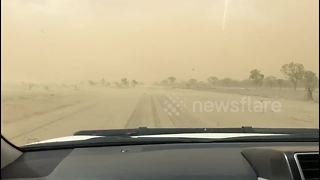 Car drives into dust after storm hits Queensland - Video