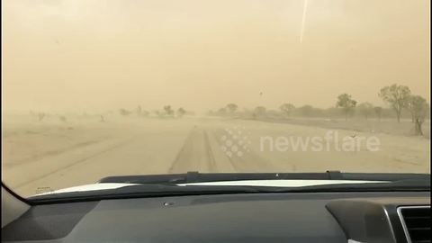 Car drives into dust after storm hits Queensland