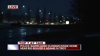 Police on scene of barricaded gunman in Troy - Video