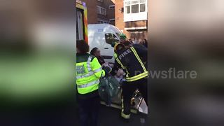 Injured woman on stretcher at Parsons Green - Video