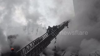 Firefighters in Brazil search for missing people after building collapse - Video