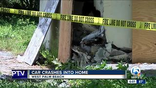 Car drives into home in West Palm Beach - Video