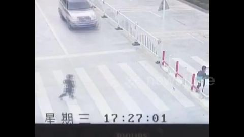 SUV runs over child playing on pedestrian crossing