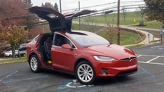 Tesla Car Offers Drivers A Christmas Secret On Its Own - Video