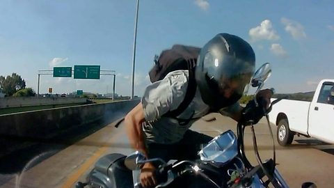 Motorbike rider struggles to brake in time and smashes into back of braking car