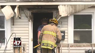 Investigators probing house fire in Lansing