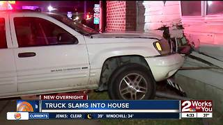 Truck slams into house near I-244 and Delaware - Video