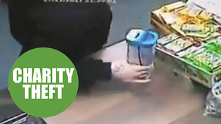 CCTV footage shows thief brazenly stealing charity collection box - Video
