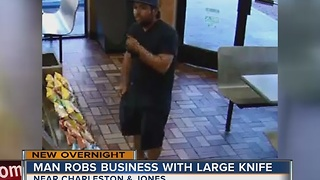 Man robs business with large knife - Video