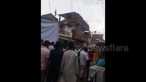 Seventeen injured when balcony collapses above procession in India