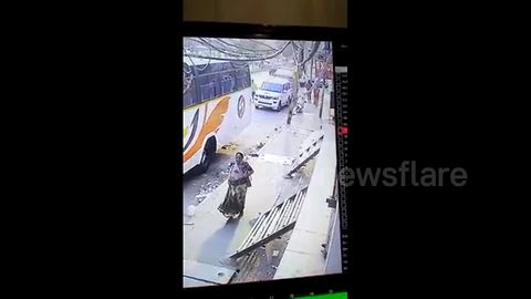 Terrifying moment armed man robs woman on busy road