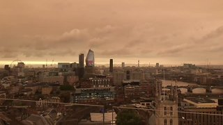 London Skyline Turns Orange as Ophelia Winds Carry Sahara Sand North - Video