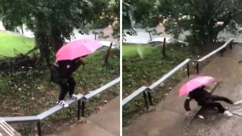 """""""this what you got to do for the fly"""" : Hilarious moment guy trying to keep his trainers dry walks along railing on to fall on his backside in a puddle"""