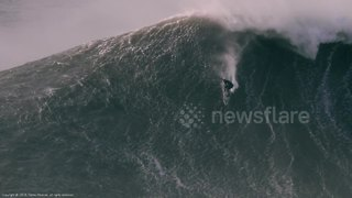 Surfer rides spectacular giant wave in Portugal's Nazaré - Video