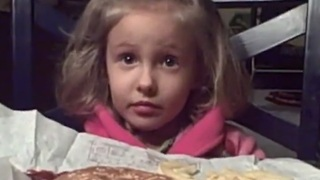 Little girl attempts to negotiate cupcake dessert - Video