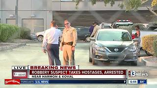 Robbery suspect takes hostages, arrested - Video