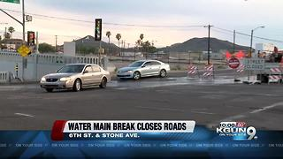 Water main break closes road - Video