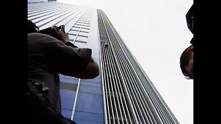 Spiderman Climbs Jakarta High-Rise - Video