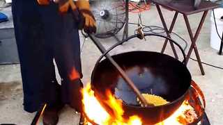 Husband And Wife Prepare Mouthwatering Popcorn The Old-Fashioned Way - Video