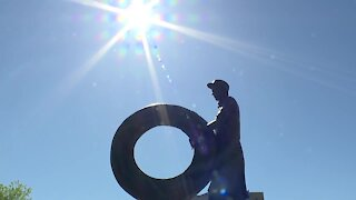 Akron unveils rubber worker statue in downtown