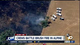 Crews battle brush fire in Alpine - Video