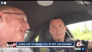 Law enforcement show what it's like to sit in a hot car