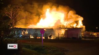 Firefighters battle warehouse fire in Fort Myers - Video