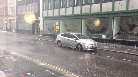 Heavy rain takes over the streets of London