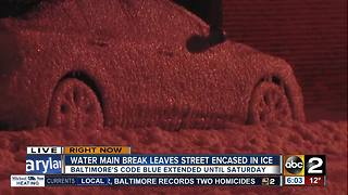 Street frozen, cars trapped in ice after water main break in Fells Point - Video