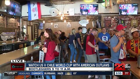 Fan club cheering Women's National Team during World Cup game