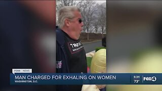 Man charged for exhaling on woman