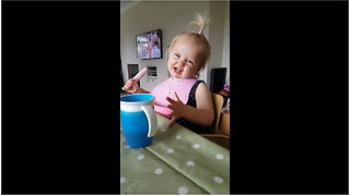 Toddler tries ice cream, gets instant brain freeze - Video