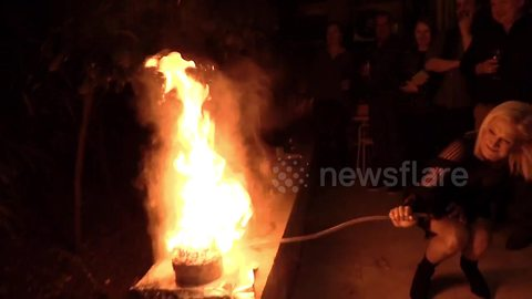 Fire ball erupts from cake at Science Teachers 50th birthday party