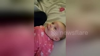 Baby Daughter Tries To Sing Along With Her Mom - Video