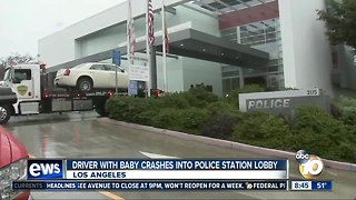 Driver with baby crashes into police station lobby.