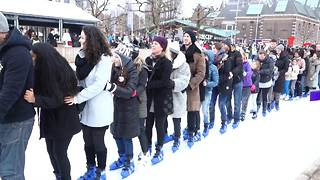 Skaters attempt to break world record for conga line on ice - Video