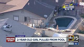 Two-year-old girl breathing on her own after being pulled from a pool - Video