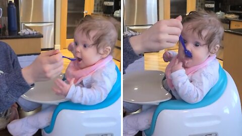 Baby's first time eating from a spoon is absolutely hilarious