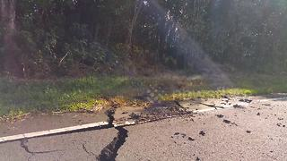 Lava spews from side of cracked road in Hawaii