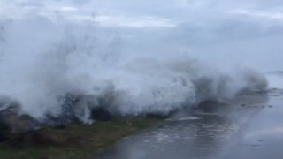 Hurricane Nate Storm Surge Splashes Up Over Florida Road - Video