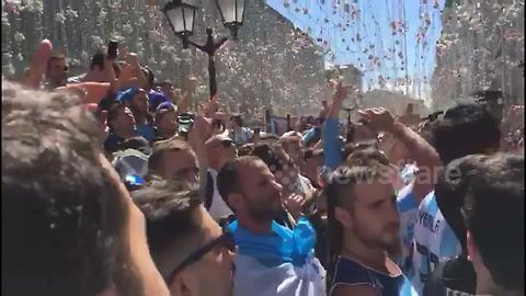 Fired-up Argentina fans jump and dance in Moscow
