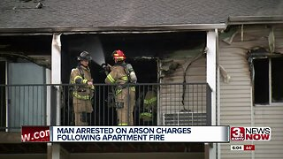 Man arrested on arson charges following apartment fire
