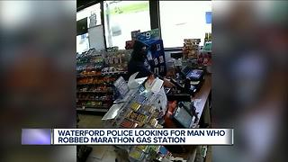 Man robs Waterford clerk at gunpoint - Video