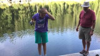 Girl Drops Fish In The Water