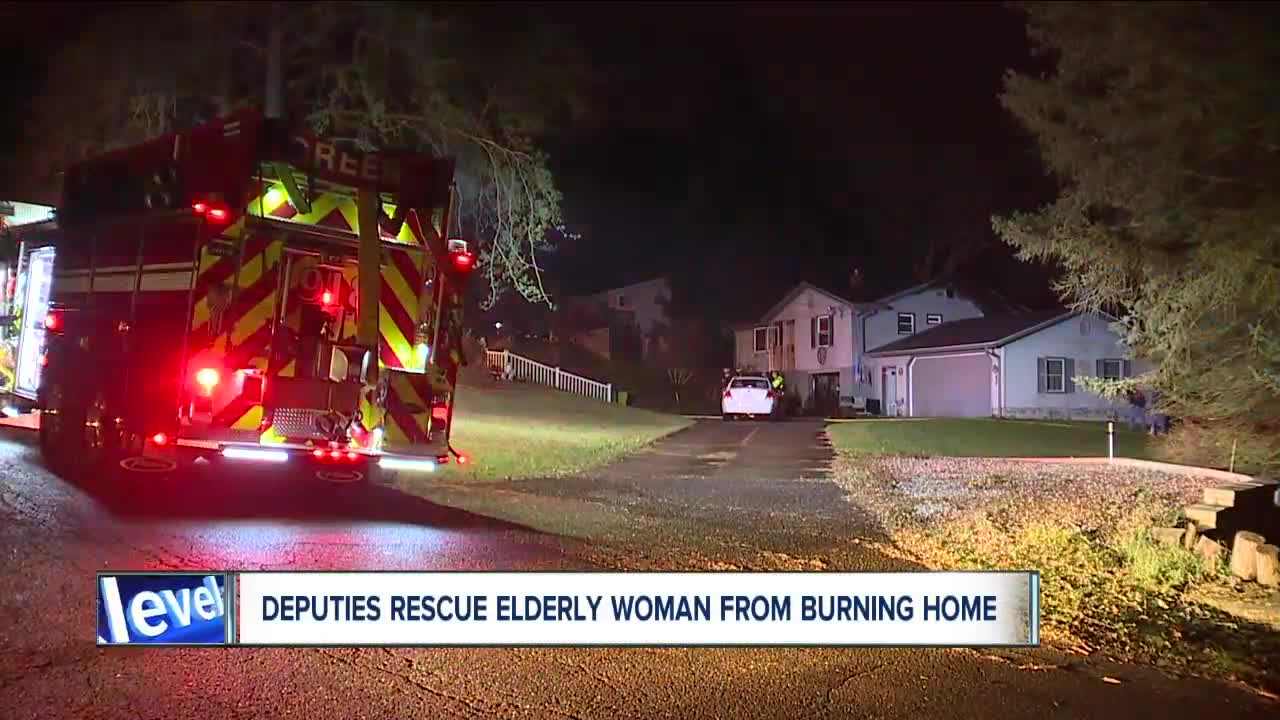 Summit County deputies hailed as heroes after rescuing elderly couple from house fire in Green