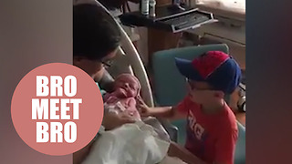 Nervous mom watches her autistic five-year-old meet his baby brother for the first time