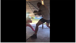 5-year-old girl intensely trains with dad to become boxer - Video