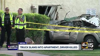 Truck slams into apartment, driver killed