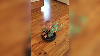 Baby Boy Rides On Roomba Vacuum - Video