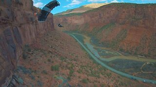 Drone Pilot Keeps Feet Safe On The Ground While Drone Takes To The Skies With Base Jumping Daredevils